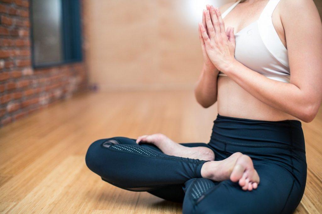 Woman meditating, practicing withdrawal of the senses.